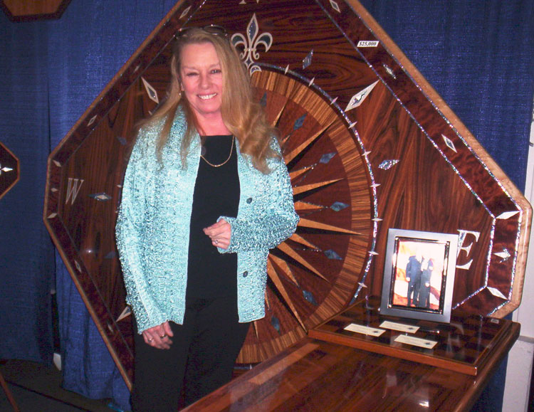 a large yacht table on display at a boat show maple walnut nautical art